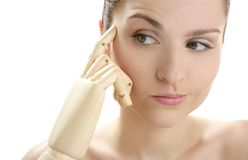 Woman portrait thinking with mannequin hand Royalty Free Stock Images