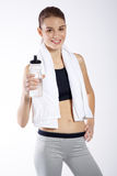 Woman portrait with a towel and bottle Royalty Free Stock Image