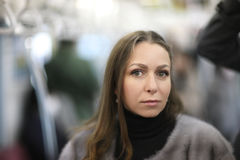 A woman. Portrait of a woman during a trip to Tokyo subway train royalty free stock photo