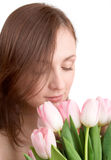 Woman portrait with tulips Stock Image