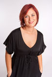 Woman portrait. Portrait of a voluptuous red haired woman Royalty Free Stock Images