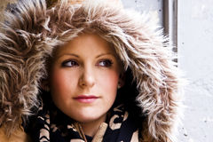 Woman portrait wearing a fur cap. Stock Photo