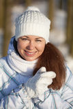 Woman portrait in winter clothes in sunlight Stock Image