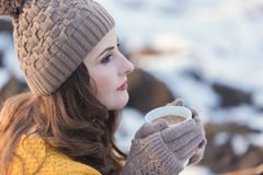 Woman Portrait. Winter portrait of a young pretty woman, drinking a cup of coffee Stock Photography