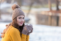 Woman Portrait. Winter portrait of a young pretty woman drinking a cup of coffee Stock Photos