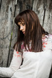 Woman portrait on wooden fence background Stock Photos