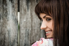 Woman portrait on wooden fence background Stock Photography