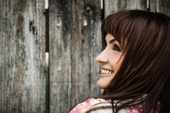 Woman portrait on wooden fence background Royalty Free Stock Photo