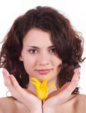 Woman portrait with yellow flower Stock Photos