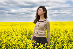 Woman portrait in yellow flower field Stock Photos