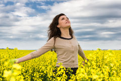 Woman portrait in yellow flower field Royalty Free Stock Image