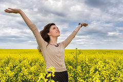Woman portrait in yellow flower field Royalty Free Stock Images