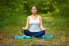 Woman portrait in yoga pose Royalty Free Stock Image