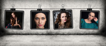 Woman portraits hanging on the rope Royalty Free Stock Image
