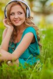 Woman portraits with headphones Royalty Free Stock Image