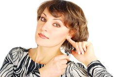 Woman portreits with earrings Royalty Free Stock Photography