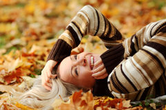 Woman portret in autumn leaf Stock Photography