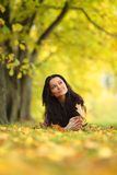 Woman portret in autumn leaf Royalty Free Stock Photo