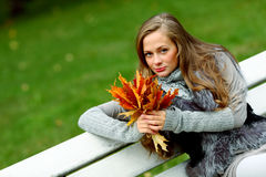 Woman portret in autumn leaf Royalty Free Stock Image