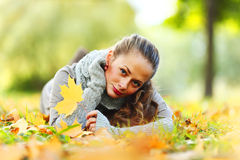 Woman portret in autumn leaf Stock Photos