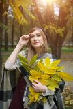 Woman portret in autumn leaf stock images