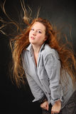 Woman pose in shirt with hair fluttering. Brown hair woman pose in shirt with hair fluttering in wind in photo studio, half body royalty free illustration