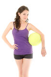 Woman  poses with a big tennis  ball Royalty Free Stock Photo