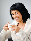 Woman poses with cup Stock Images