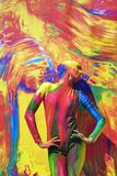 Woman poses for fotos at colorful background. Stock Photo