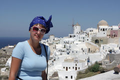 Woman poses on Oia background at Santorini Stock Photography