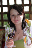 Woman poses with wineglass. At summer house Stock Photo