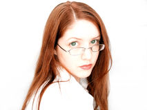 Woman Posing. Young woman looking into camera, serious expression, looking over glasses royalty free stock photo