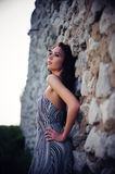 Woman Posing Against Stone Wall Stock Photos