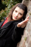 Woman is posing against a wall Stock Photo
