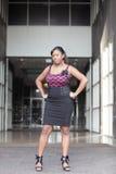 Woman posing akimbo Royalty Free Stock Photography