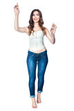 Woman posing arms outstretched, pointing his finger. royalty free stock photography