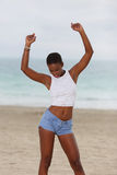 Woman posing with arms raised Stock Photo