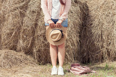 Woman posing around hands of a haystack Stock Photography
