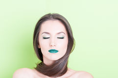 Woman posing as beauty concept with eyes closed. Wearing professional trendy make-up Royalty Free Stock Photo