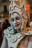 A woman posing as a living statue at a festival Royalty Free Stock Photography