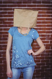 Woman posing with bag on head Royalty Free Stock Photo