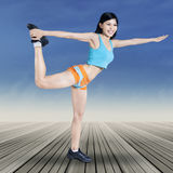 Woman posing on balance exercise Stock Image