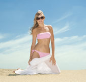Woman posing on the beach Stock Images