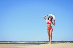 Woman posing at the beach Stock Photos