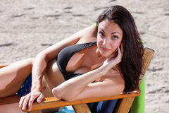 Woman posing on a beach chair Stock Photography