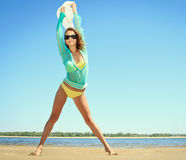 Woman posing at the beach on summer day Stock Images