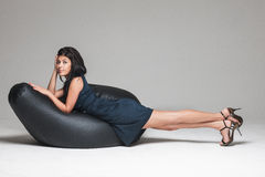 Woman posing on beanbag Stock Photography