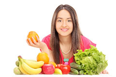 Woman posing behind fruits and vegetables Royalty Free Stock Photos