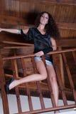 Woman posing behind wooden baluster Royalty Free Stock Image