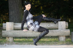Woman posing on bench in the autumn park Royalty Free Stock Image